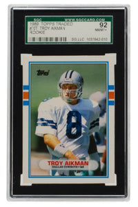 Troy Aikman 1989 Topps #70T Dallas Cowboys Rookie Football Card SGC 92 NM/MT+ - Sports Integrity
