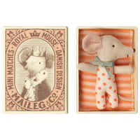 linen plush baby mouse with coral one piece outfit in striped bedding in a matchbox bed