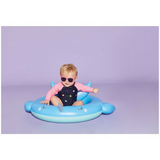 baby sitting in blue narwhal inflatable baby float | SaplingShop