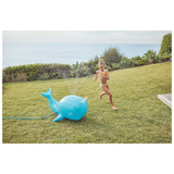 Image of child running around blue narhwal inflatable sprinkler | SaplingShop