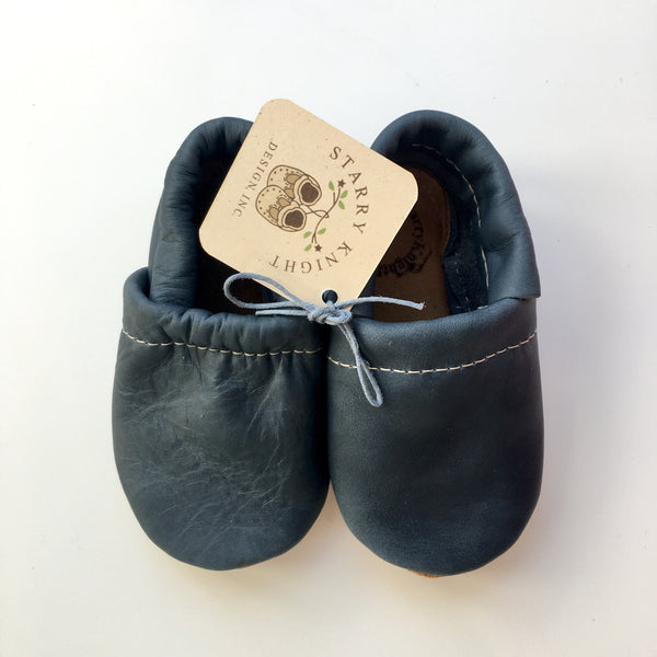 denim blue leather baby moccasin with inner elastic at top