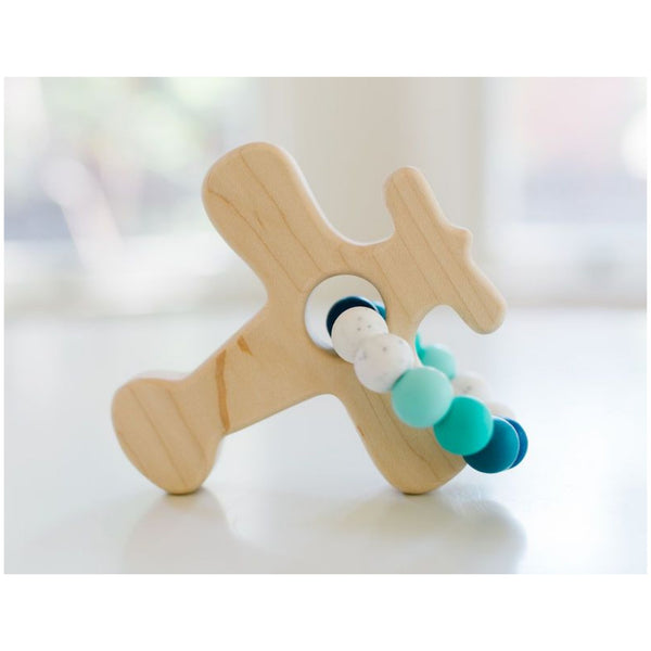 Wooden airplane teether with a variety of colors of blue silicone teething beads attached
