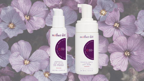 mother dirt prebiotic acne lotion and prebiotic foaming cleanser with jojoba on purple floral background
