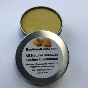 All Natural Leather Conditioner opened 2 oz tin with beeswax colored product