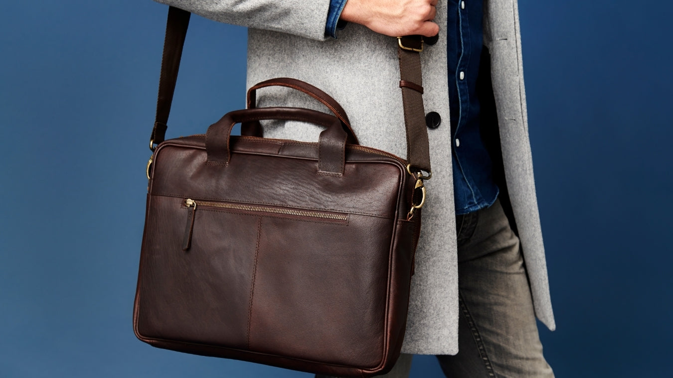 formal wear with leather messenger bag
