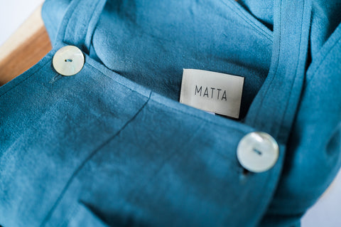MATTA Clothing Crossback Dungarees in Spruce coloured washed linen.