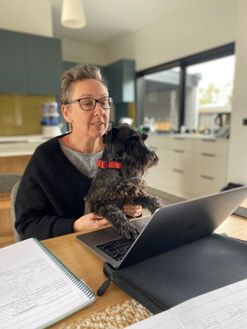 Nicole working with Bob the Dog at her laptop