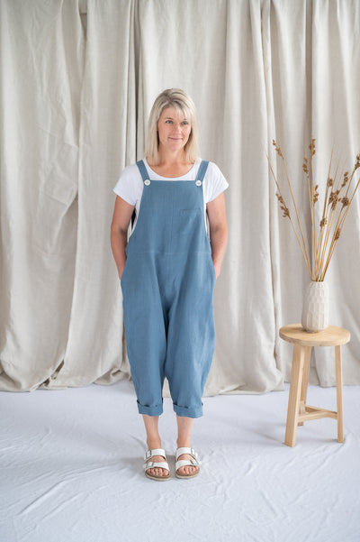 Our Model is wearing the Cropped Crosssback Dungarees - Cornflower by Matta Clothing Australia.