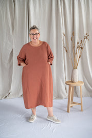 Our Model is wearing the Tilly Dress - Toffee by Matta Clothing Australia.