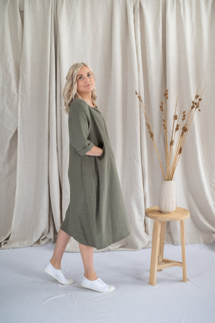 Our Model is wearing the Tilly Dress - Sage by Matta Clothing Australia.