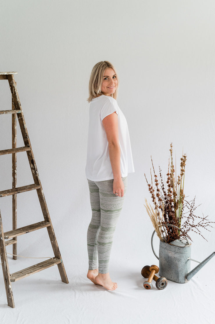 Our Model is wearing the Travel Pants - Grey Marle/Moss Green by Matta Clothing Australia.