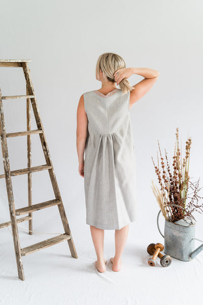 Our Model is wearing the Orchard Dress - Linen in Oyster/Blush by Matta Clothing Australia.