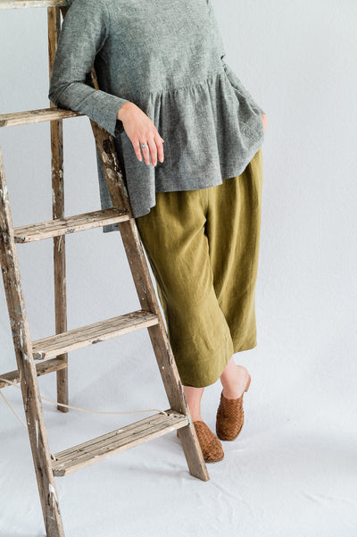 Our Model is wearing the Vespa Pant - Antique Washed Linen in Olive by Matta Clothing Australia.