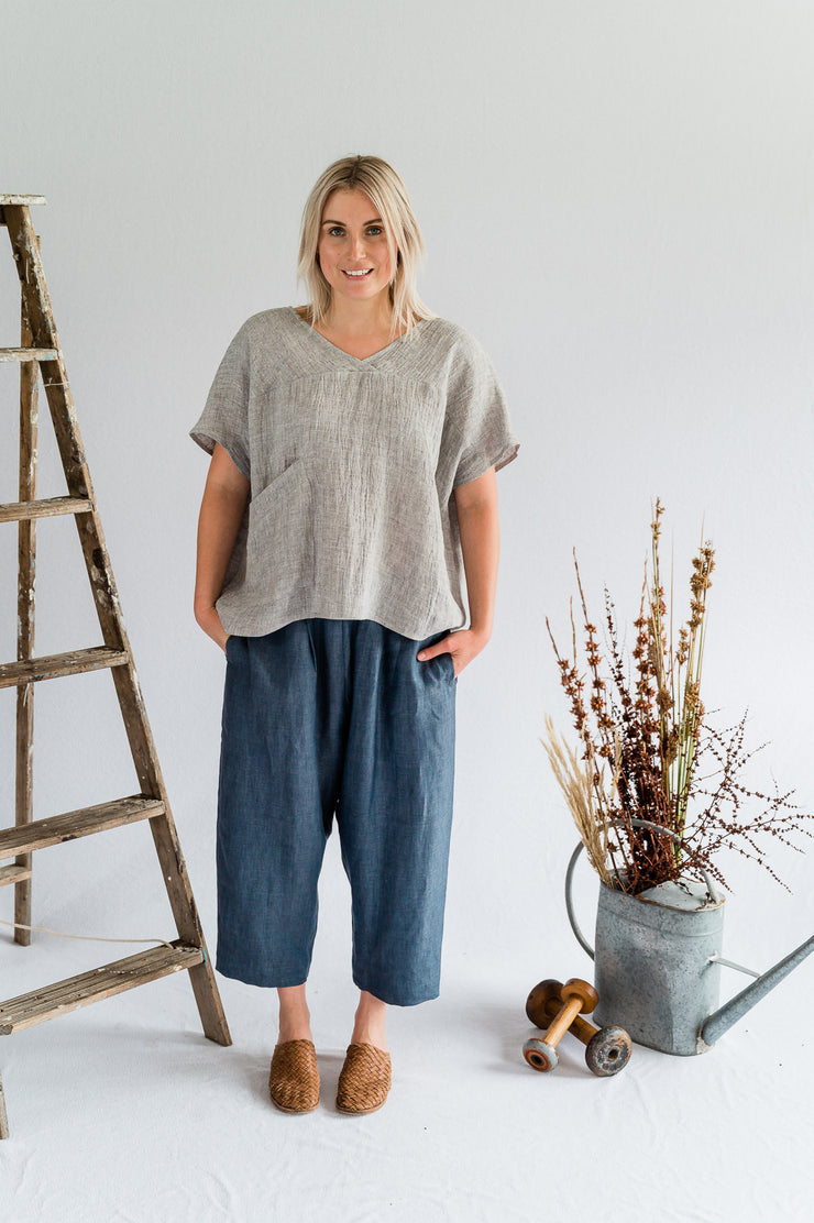 Our Model is wearing the Gallery Pant - Linen in Ash Blue by Matta Clothing Australia.