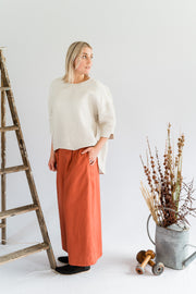 Our Model is wearing the Coastal Pant - Linen in Paprika by Matta Clothing Australia.