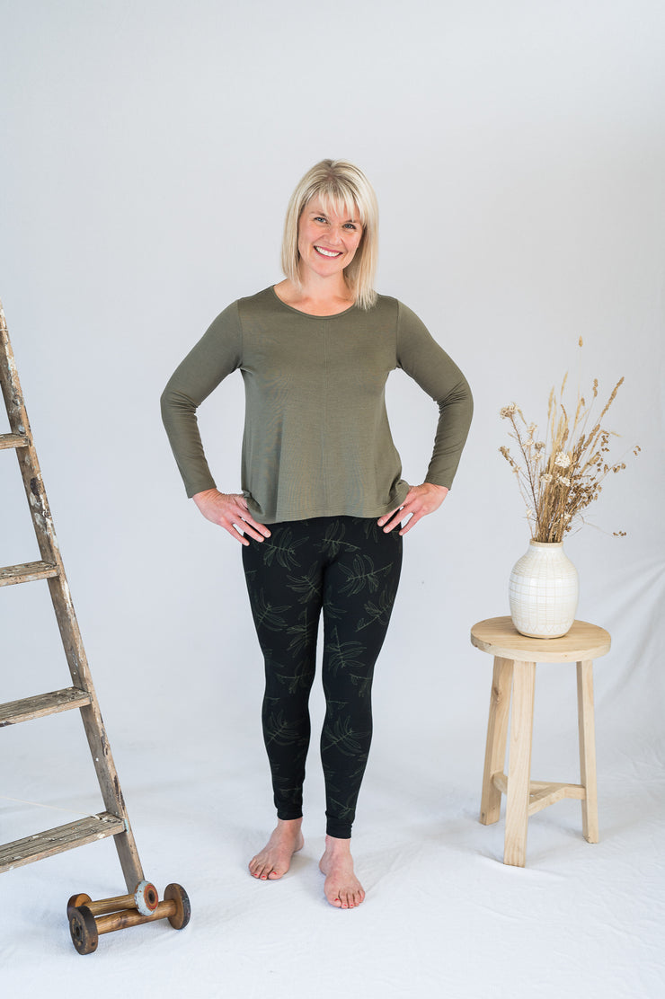 Our Model is wearing the HI-Lo Long Sleeve Merino Top - Khaki by Matta Clothing Australia.