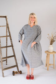 Our Model is wearing the Gretel Dress - Navy Gingham by Matta Clothing Australia.