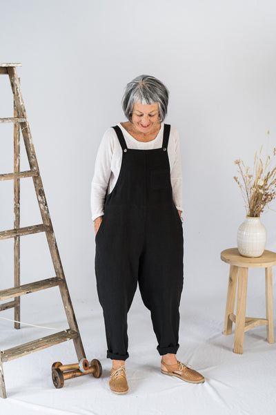 Our Model is wearing the Crosssback Dungarees - Black Antique Washed Linen by Matta Clothing Australia.