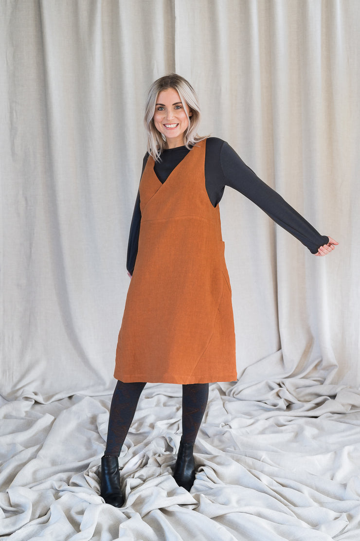 Our Model is wearing the Crossback Tunic - Ochre Antique Washed Linen by Matta Clothing Australia.