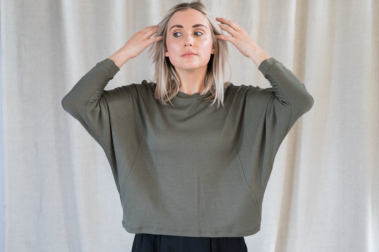 Our Model is wearing the Batwing Merino - Khaki by Matta Clothing Australia.