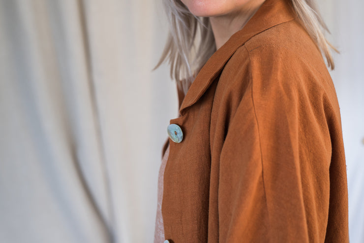Our Model is wearing the Mabel Linen Jacket - Ochre by Matta Clothing Australia.