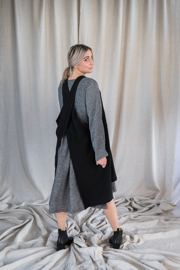 Our Model is wearing the Linen Apron - Washed Black by Matta Clothing Australia.