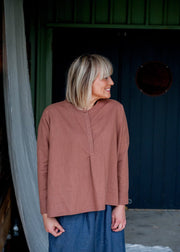 Our Model is wearing the Editor Linen Shirt - Clay by Matta Clothing Australia.