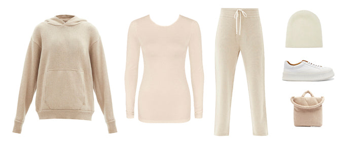 Fashion styling flatlay of cream jumper, thermal top, tracksuit pants
