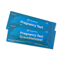 two pregnancy tests in their individual blue packaging with the words 'Pregnancy test' on the outside in English and Swedish