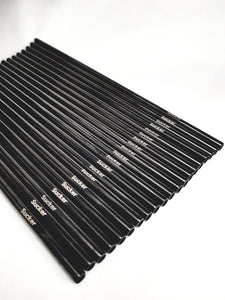 Reusable Metal Straws - 500 Straws with 50 Brushes - 20 SuckerStraws reusable metal straws in a neat row showing the brand name. SuckerStraws are bulk wholesale reusable metal straws for bars and restaurants available worldwide.