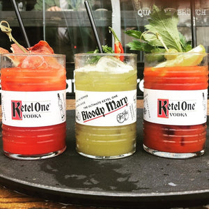 Buy 100 reusable metal SuckerStraws - three bloody mary cocktails shown in Ketel One glasses with black reusable metal straws