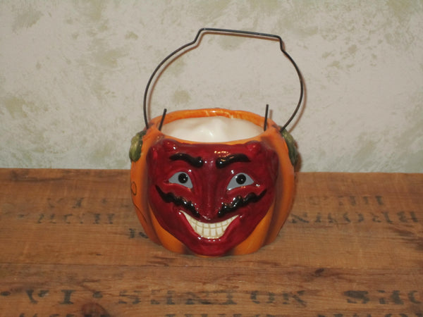 Snarling devil pumpkin candle holder