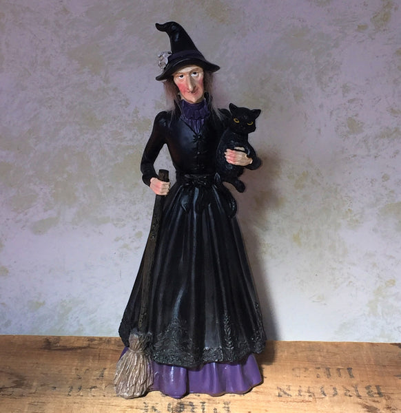 Witch holding cat figure