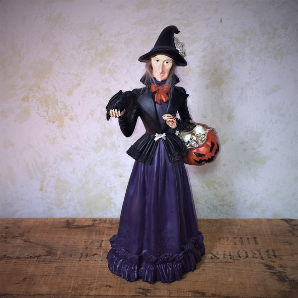 Witch with raven figure