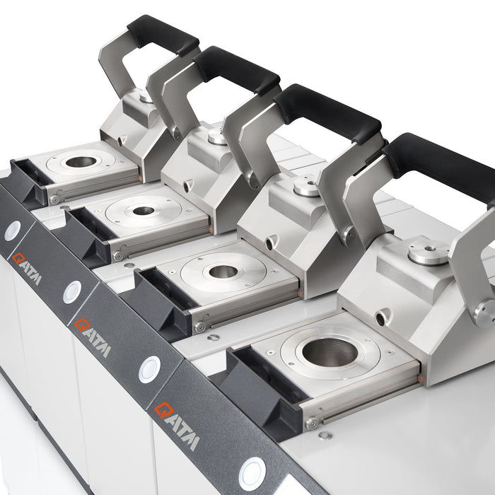 Qpress 50-4 mounting press with various-sized mounting cylinders