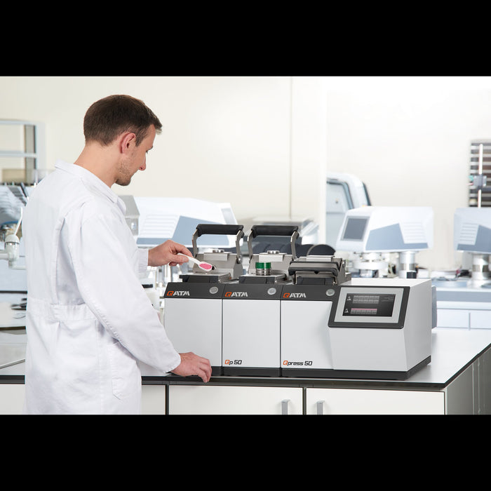 Operator in lab using the QATM Qpress 50-4 Mounting Press