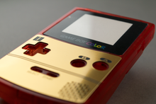 Load image into Gallery viewer, Famicom Style Gold Veneer for Game Boy Color