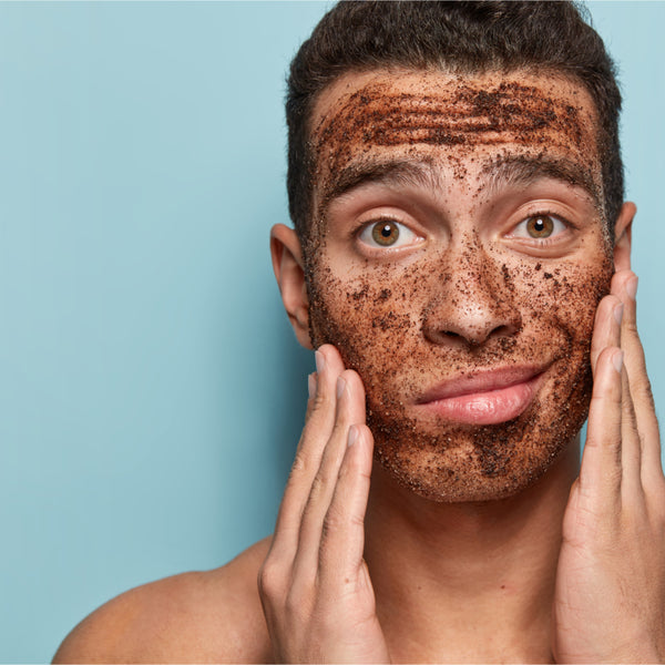 Young man with scrub on his face. BOA exfoliant