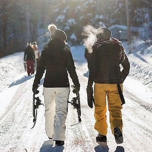 Women snowshoeing Rangeley Lake Maine trails