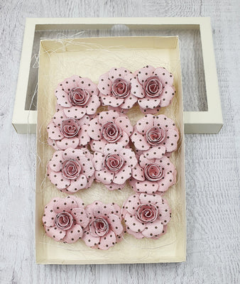 Handmade paper flowers in a box
