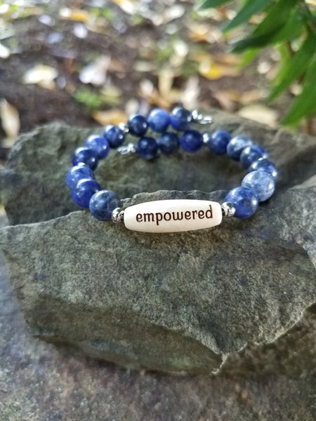 Empowered. Blue Sodalite Gemstone and Engraved Wood Beaded Bracelet. Crystal Energy Healing Jewelry.