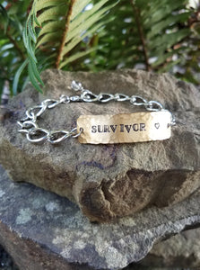 Survivor. Hand Stamped Inspirational Quote Bracelet. Brass and Silver Metal with Quartz Crystal.