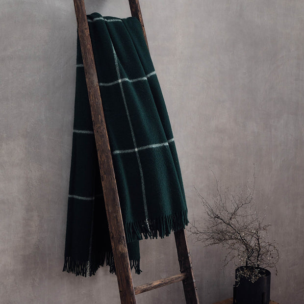 Saldus Wool Blanket in dark green & cream | Home & Living inspiration | URBANARA