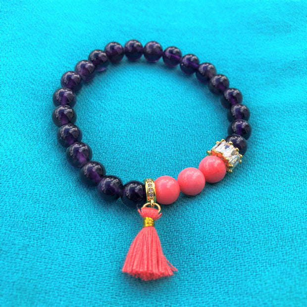 Wisdom and Love in this Amethyst and Coral Bracelet