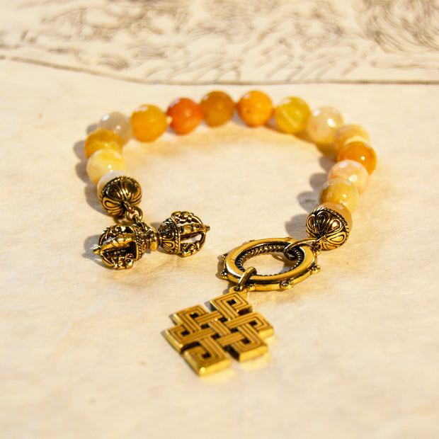 Faceted Yellow Agate w/brass Dorje and Eternal Knot