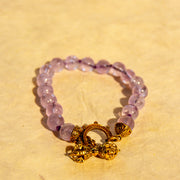 Amethyst Faceted Bracelet with Brass Dorje Clasp