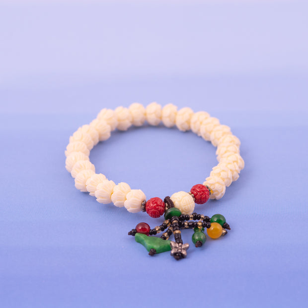 Coral and White Carved Bead Bracelets