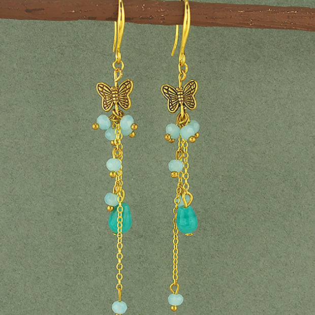 Turquoise Dangle Earring with Butterfly Charm.