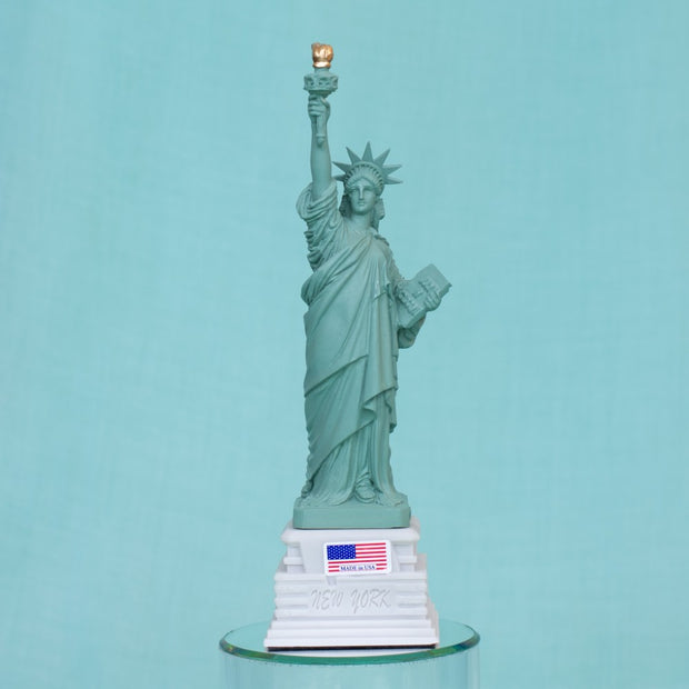 Statue of Liberty on Base with American Flag