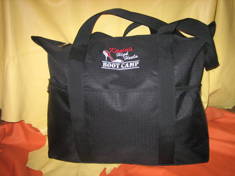 Black tote bag with zipper and small zipper and mesh packets on the side.